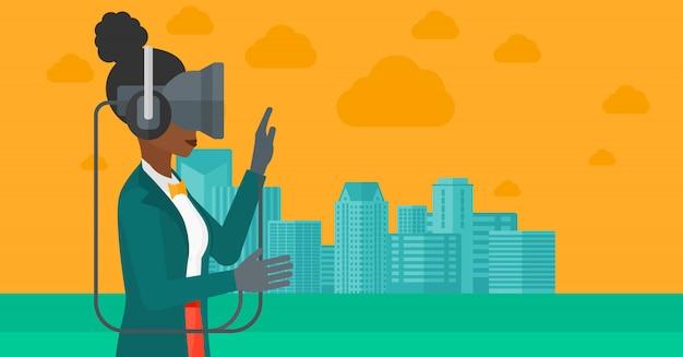 仮想現実のヘッドセットを着ている女性