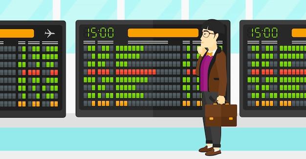 Человек смотрит на расписание