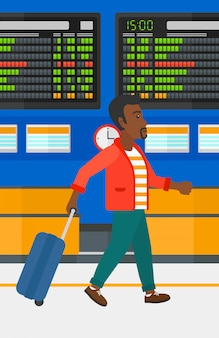 スーツケースで歩く男
