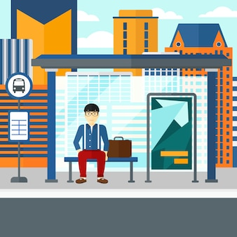 バスを待っている男