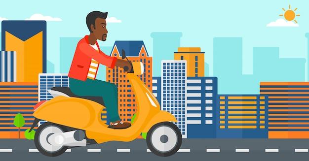 Человек езда скутер.
