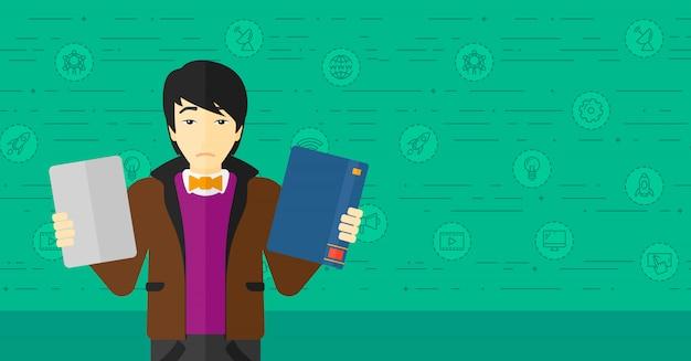 Человек выбирая между книгой и планшетом.