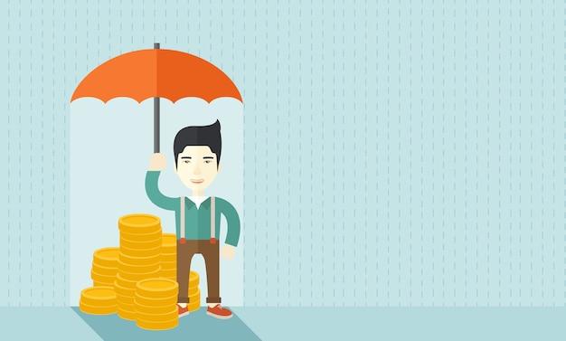 彼の投資の保護として傘を持つ中国の実業家。