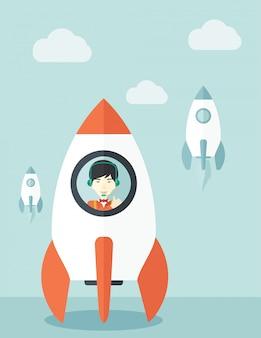 ロケットの側で若いアジア人の男。