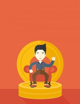 座っている笑顔の成功した日本のビジネスマン