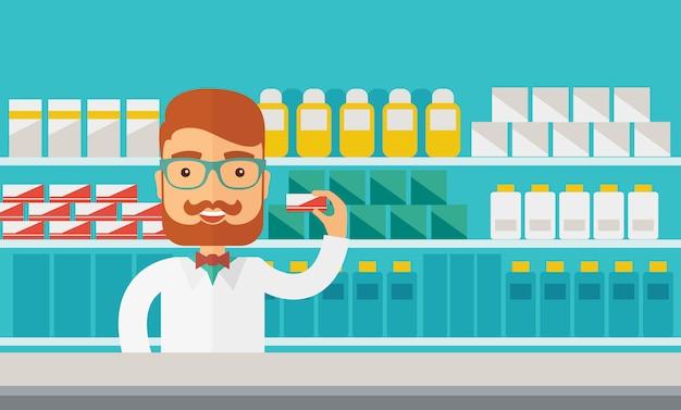 ドラッグストアで立っている若い薬局化学者男。