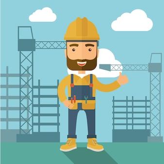 Человек стоя перед башней крана конструкции.