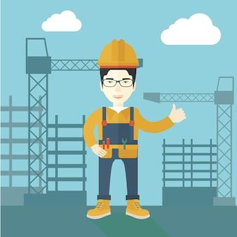 建設クレーンタワーの前に立っている男。