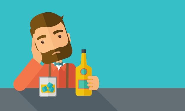 ビールを飲みながらバーで一人で悲しい男。