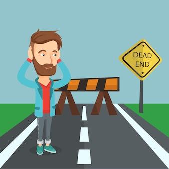 道路標識の行き止まりを見てビジネスの男性。