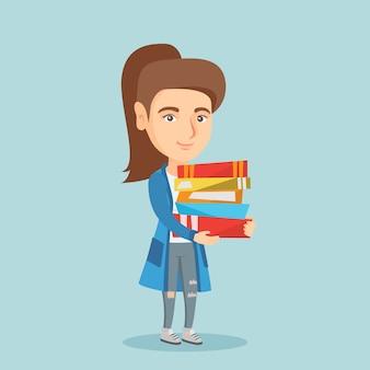 Молодой кавказский студент держа кучу книг.