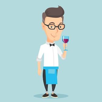 Бармен держит бокал вина в руке.