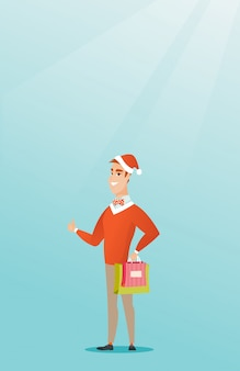 サンタの帽子のクリスマスプレゼントの買い物の男。