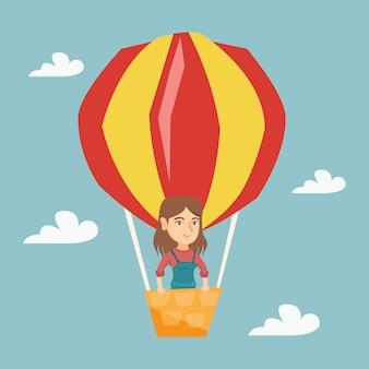熱気球で飛んでいる若い白人女性。