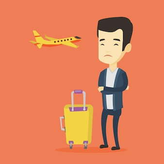 Молодой человек страдает от страха полета.