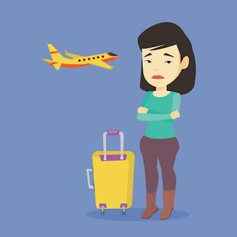 飛行の恐怖に苦しむ若い女性。
