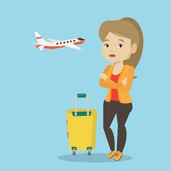 Молодая женщина страдает от страха полета.