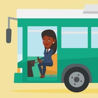 ステアリングホイールに座っているアフリカのバスの運転手。
