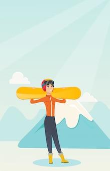 Молодая кавказская спортсменка держа лыжи.