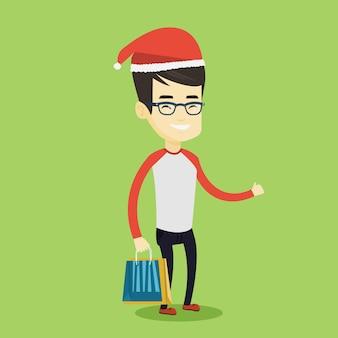 Человек в шляпе санта, ходить по магазинам для рождественских подарков.