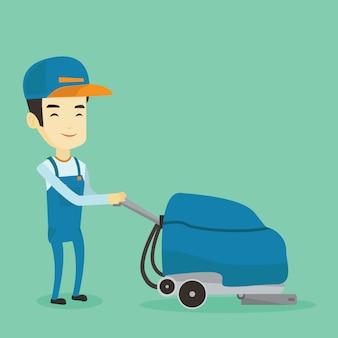 機械で店の床を掃除する労働者。