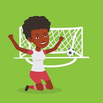 得点ゴールを祝うサッカー選手。