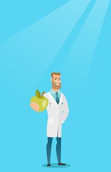 新鮮なリンゴを提供する栄養士。