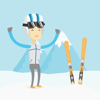 Веселый лыжник, стоя с поднятыми руками.