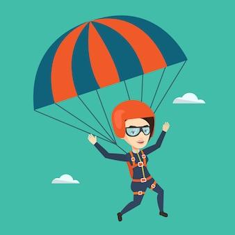 パラシュートで飛んで若い幸せな女。