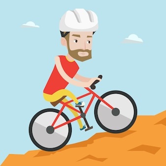 山を旅行する自転車の若い男。