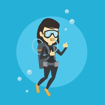 Женщина, ныряющая с аквалангом и показывающая хорошо, подписывается.