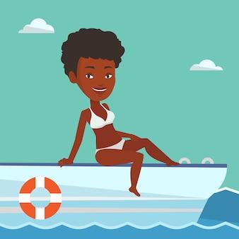 ヨットで日焼け若い幸せな女。