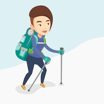 Молодой альпинист, восхождение на снежный хребет.