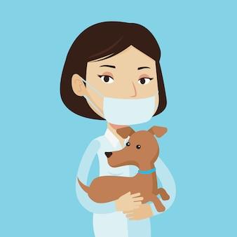 Ветеринар с собакой в руках