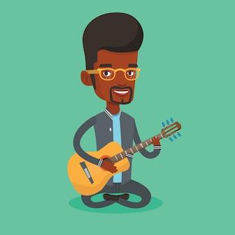 アコースティックギターのイラストを弾く男。