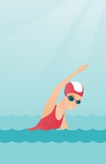 Молодая кавказская спортсменка плавает