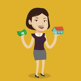 Женщина покупает дом благодаря кредиту.