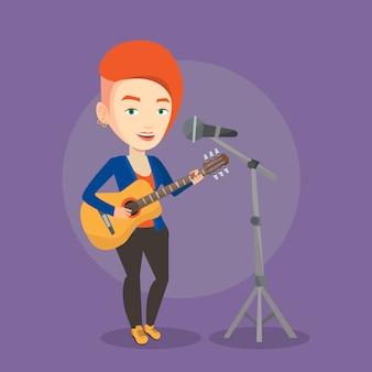 マイクで歌って、ギターを弾く女性。