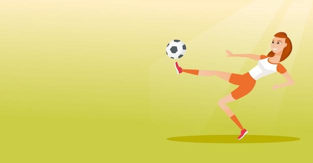 ボールを蹴る若い白人のサッカー選手
