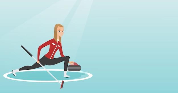 スケートリンクでカーリングをしているスポーツウーマン