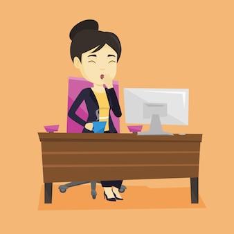 オフィスであくび疲れた従業員。