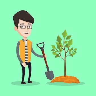Человек сажает дерево.