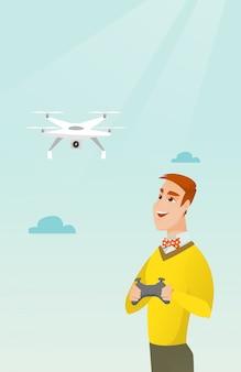 Молодой кавказский человек летающий дрон