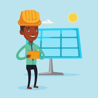 太陽光発電所の男性労働者。