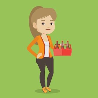 ビールのパックを持つ女性。