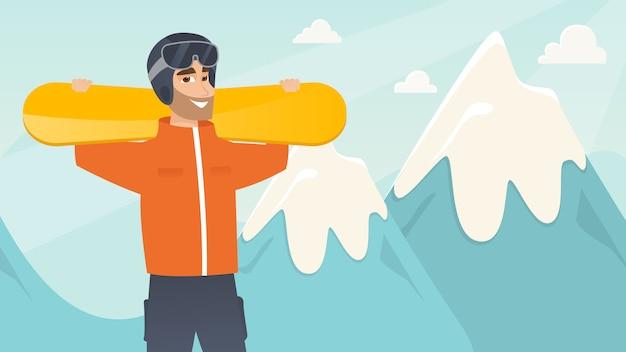 Молодой кавказский спортсмен держа лыжи