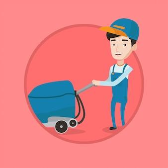 男性労働者が機械で店の床を掃除します。