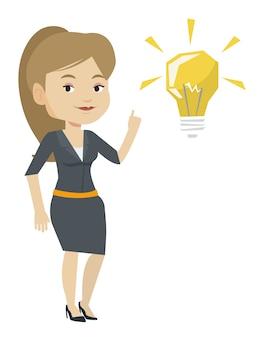 アイデア電球のベクトル図を指して学生