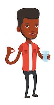 Молодой человек афроамериканцев, принимая таблетки.