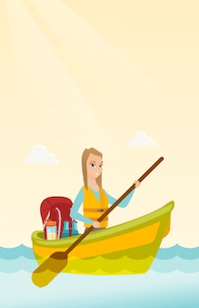 カヤックに乗って若い白人女性。